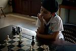 A cuban schoolboy playing chess.