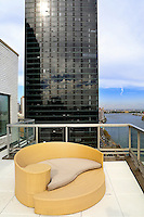 modern yellow sofa<br /> <br /> This sprawling 3,200 sq. ft. penthouse features four bedrooms, four bathrooms and two half bathrooms on three levels along with an additional 2,400 sq. ft. of expansive wraparound terrace.  This penthouse's dramatic design is exceeded only by it's illustrious past. Frank Sinatra, the apartment's original owner, helped design the triplex which played host to some of New York's legendary gatherings