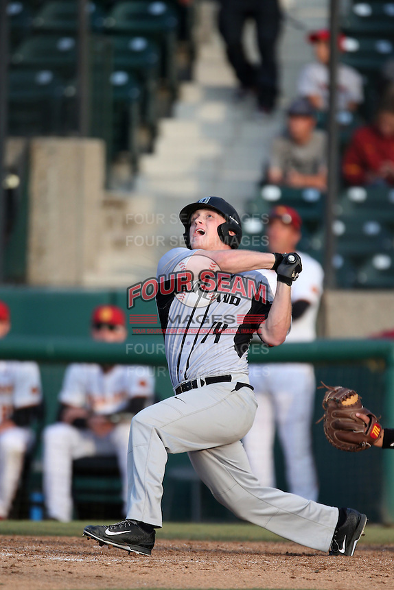 Ben Hart (14) of the Oakland Grizzlies bats during a game against the Southern California Trojans at Dedeaux Field on February 21, 2015 in Los Angeles, California. Southern California defeated Oakland, 11-1. (Larry Goren/Four Seam Images)