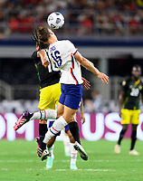 DALLAS, TX - JULY 25: James Sands #16 of the United States heads the ball over Bobby Reid #10 of Jamaica during a game between Jamaica and USMNT at AT&T Stadium on July 25, 2021 in Dallas, Texas.