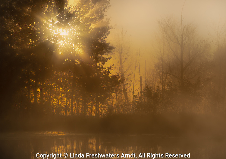 A foggy sunrise over a northern Wisconsin lake.