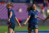 ORLANDO, FL - FEBRUARY 21: Becky Sauerbrunn #4 and Christen Press #23 of the USWNT warms up before a game between Brazil and USWNT at Exploria Stadium on February 21, 2021 in Orlando, Florida.