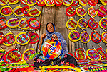 Workers skillfully embroider hand fans with brightly coloured geometric shapes.  They use bamboo and colourful yarn to create intricately designed fans whilst sitting in their homes.<br /> <br /> Each worker makes up to ten fans a day, with each fan being sold for around 30 pence at village fairs.  Photographer Abdul Momin pictured the technique in Gaibandha, Bangladesh.  SEE OUR COPY FOR DETAILS.<br /> <br /> Please byline: Abdul Momin/Solent News<br /> <br /> © Abdul Momin/Solent News & Photo Agency<br /> UK +44 (0) 2380 458800