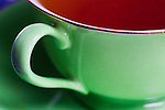 Cup of Tea in Green China Cup with Gold Leaf Rim