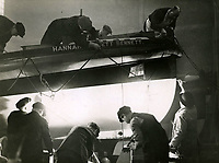 BNPS.co.uk (01202 558833)<br /> Pic: RNLI<br /> <br /> At work on Hoylake lifeboat 'Hannah Fawcett Bennett', RNLI's Poplar Depot, December 1935<br /> <br /> Splash in the Attic...<br /> <br /> A 'lost' cache of 13,000 photographs charting the history of the RNLI has been found in the attic of the charity's headquarters.<br /> <br /> Many of the black and white photos date back to the 1920s and '30s long before the terms 'health and safety' and 'risk assessment' were thought of.<br /> <br /> One image depicts a brave lifeboatman dressed in a suit and cloth cap just as the lifeboat he is on launches down a ramp into a choppy sea.<br /> <br /> Another shows the crew of another open lifeboat getting swamped by waves with only their souwesters and lifejackets to protect them.<br /> <br /> The photos have been unearthed in storage space at the RNLI HQ in Poole, Dorset, and they are now being digitised.