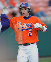 Jason Stolz (2) is congratulated after scoring a run in a game between the Charlotte 49ers and Clemson Tigers Feb. 20, 2009, at Doug Kingsmore Stadium in Clemson, S.C. (Photo by: Tom Priddy/Four Seam Images)