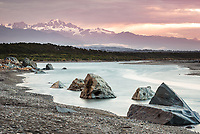 Pastel sunset over Southern Alps with Mt. Tasman in view from Harihari Beach, West Coast, South Westland, New Zealand