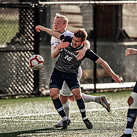 9 April 2021: University of New Hampshire Wildcat Men's Soccer Backfielder Sam Henneberg, a Graduate Student from Guildford, England, battles University of Vermont Catamount Defender Bjarni Aðalsteinsson, a Freshman from Akureyri, Iceland, in first-half action at Virtue Field in Burlington, Vermont. The Wildcats defeated the Catamounts 2-1 in America East, Division 1 play. Mandatory Credit: Ed Wolfstein Photo *** RAW (NEF) Image File Available ***
