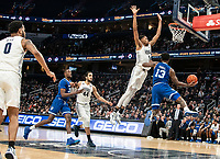 WASHINGTON, DC - FEBRUARY 05: Myles Powell #13 of Seton Hall goes around Jamorko Pickett #1 of Georgetown for a shot during a game between Seton Hall and Georgetown at Capital One Arena on February 05, 2020 in Washington, DC.