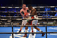 David Adeleye (white/red shorts) defeats Mladen Manev during a Boxing Show at the SSE Arena on 24th July 2021