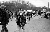 Machine Gun Shoot<br /> Knob Creek<br /> Westpoint, Kentucky<br /> USA<br /> April 4, 2009<br /> <br /> Nearly 16,000 people attend the Knob Creek Machine Gun Shoot & Military Gun Show. It is the largest gathering of Civilian owned machine guns in the world. The gun show has over 700 tables with machine guns, military surplus, ammo, hard to find parts & pieces and regular firearms and supplies.<br /> <br /> Firearms sales have surged in the six months since Obama's election as millions of Americans have gone on a buying spree that has stripped gun shops in some parts of the country almost bare of assault weapons and led to a national ammunition shortage.<br /> <br /> The FBI says that since November more than seven million people applied for criminal background checks in order to buy weapons, a figure excluding the many more buying at thousands of gun shows in states such as Virginia, without facing any checks.<br /> <br /> Gun-shop owners and the National Rifle Association say the surge is driven by worries that Obama is planning to ban many types of firearms and that the deepening economic crisis will fuel a crime wave, as witnessed by the string of mass shootings in the past few weeks.<br /> <br /> But control groups pressing for greater control on firearms accuse the NRA of funding a massive scare campaign to portray Obama as a gun owner's worst nightmare and to argue that tighter restrictions on weapons ownership are a threat to broader liberties and a step toward tyranny.