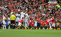 Pictured: Swansea players jump trying to block a free kick taken by Wayne Rooney of Manchester United (10). Saturday 16 August 2014<br /> Re: Premier League Manchester United v Swansea City FC at the Old Trafford, Manchester, UK.