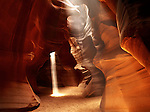 A single shaft of sunlight illuminates airborne particles of dust. Upper Antelope Canyon in Arizona is about 40 meters (130 feet) deep and except for a couple chambers, it is extraordinarily narrow and twisted.
