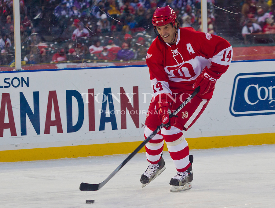31 December 2013: Former Detroit Red Wings forward Brendan Shanahan (14) skates with the puck during the Toronto Maple Leafs v Detroit Red Wings Alumni Showdown hockey game, at Comerica Park, in Detroit, MI.