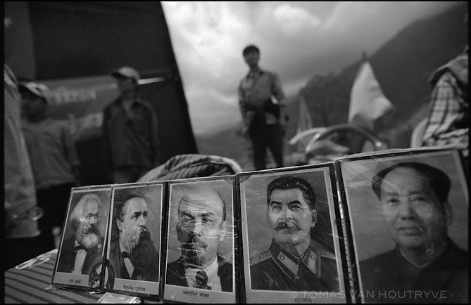 """Photos of communist icons Marx, Engels, Lenin, Stalin and Mao form part of the decorations for the inauguration ceremony for the Maoist rebel """"Martyr's Road,"""" celebrating the opening of the first section of the road in Tila, Nepal on 24 June, 2005.<br />"""