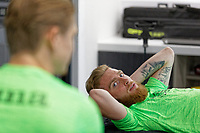 Pictured: Oli McBurnie lays on the physiotherapist bed. Thursday 27 June 2019<br /> Re: Swansea City FC players report for training at Fairwood training ground, UK