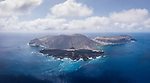 San Benedicto Island, Revillagigedos Islands, Mexico; a panoramic aerial view of the cinder cone and lava flow into the Pacific ocean from the 1952 volcanic eruption, with the Socorro Vortex and Solmar V liveaboard dive boats, anchored at El Canon dive site