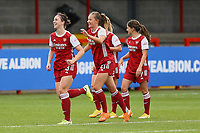 Lotte Wubben-Moy (left) of Arsenal scores goal number 4 for her team and celebrates with Malin Gut of Arsenal  and Danielle Van de Donk (right) of Arsenal during Brighton & Hove Albion Women vs Arsenal Women, Barclays FA Women's Super League Football at Broadfield Stadium on 11th October 2020