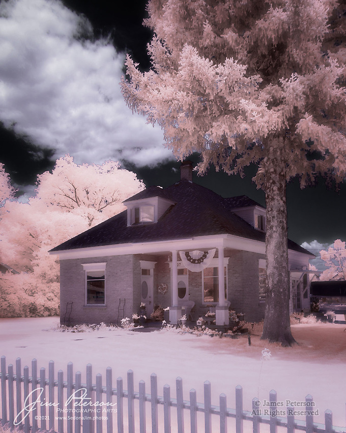 Historic Home in Panguitch (Infrared).  Southern Utah has many small cities and settlements, and they have many interesting homes that were built by Mormon settlers in past centuries.  This one, over 100 years old, is just off Main Street in this picturesque town near Red Canyon. <br /> <br /> Tech info: Nikon D3200 camera (modified for infrared with 590nm filter), Nikon 18-140mm lens at 18mm, 1/250 sec. at f11, ISO 200.<br /> <br /> Image ©2021 James D. Peterson