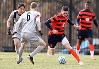 WASHINGTON, DC - NOVEMBER 25, 2012: Ian Christianson (6) of Georgetown University defends against Ted Cribley (5) of Syracuse University during an NCAA championship third round match at North Kehoe field, in Georgetown, Washington DC on November 25. Georgetown won 2-1 after overtime and penalty kicks.