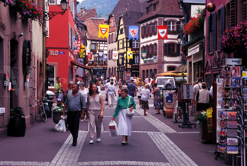 France, Alsace, Ribeauville, Haut-Rhin, Europe, wine region, People walking along the narrow streets surrounded by half-timbered buildings in the picturesque village of Ribeauville in the wine region of Alsace.