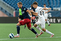FOXBOROUGH, MA - JULY 9: Pierre Cayet #44 of New England Revolution II dribbles as Antonio Carlini #85 of Toronto FC II defends during a game between Toronto FC II and New England Revolution II at Gillette Stadium on July 9, 2021 in Foxborough, Massachusetts.