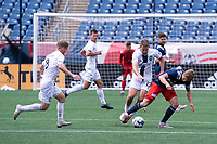 FOXBOROUGH, MA - JULY 4: Justin Rennicks #12 of the New England Revolution II retrieves the ball under pressure from Evan Lee #12 of Greenville Triumph SC during a game between Greenville Triumph SC and New England Revolution II at Gillette Stadium on July 4, 2021 in Foxborough, Massachusetts.