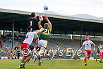 Niall Morgan, Tyrone, goes highest in an aerial duel over Tommy Walsh, Kerry, during the Allianz Football League Division 1 Semi-Final, between Tyrone and Kerry at Fitzgerald Stadium, Killarney, on Saturday.