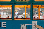 A bustling street behind an empty bus, Kolkata, India