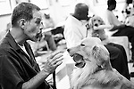 BEACON, NEW YORK:  Ed instructs Midas to hold and a can during their once-a-week class for the Puppies Behind Bars Program at Fishkill Correctional Facility. Ed has been in prison for 16 years and is serving 20 years to life. He's been in the program since 2003. The puppies live with the prisoners full-time and accompany them wherever they go on the prison grounds while they are trained to be service dogs.