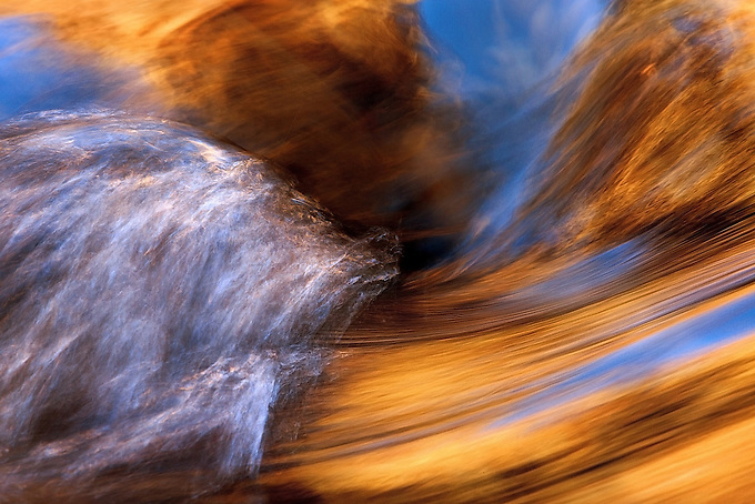 Gold and blue reflected on a small cascade deep in the Narrows of the Virgin River, Zion NP.