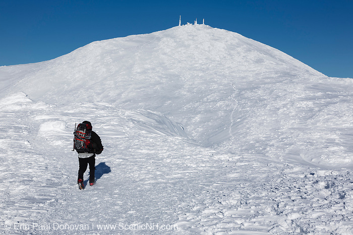 Appalachian Trail - Winter hiker on the summit of Mount Monroe during the winter months in the White Mountains, New Hampshire USA. Mount Washington is in the background