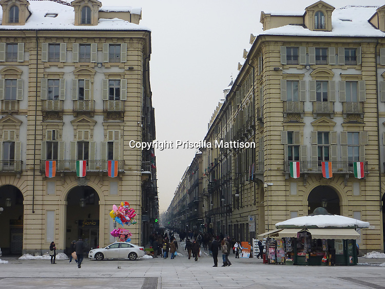 Turin, Italy - February 4, 2012:  Colorful balloons brighten Piazza Castello in winter.