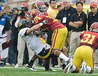 Chris Conte of California tackles Robert Woods of USC during the game at LA Memorial Coliseum in Los Angeles, California.  USC defeated California, 48-14.