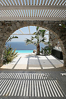MEGALOKONOMOS GIORGOS....The architect Megalokonomos Giorgos designed a country house at Costa Helios, one of the quietest places on the island of Mykonos. A comfortable house with a swimming pool and an amazing view to the Aegean, it combines the traditional character of the island with modern architecture. ..