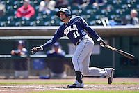 Miguel Rojas (11) of the New Orleans Zephyrs swings at pitch against the Iowa Cubs at Principal Park on April 23, 2015 in Des Moines, Iowa.  The Zephyrs won 9-2.  (Dennis Hubbard/Four Seam Images)