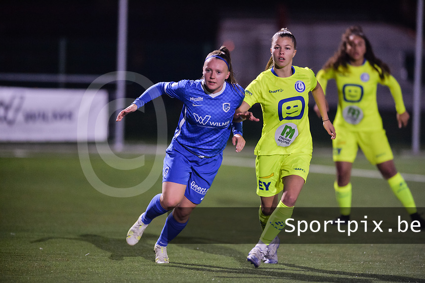 Fleur Pauwels (66) of KRC Genk and Lyndsey Van Belle (14) of AA Gent pictured during a female soccer game between  Racing Genk Ladies and AA Gent Ladies ,  on the 6 th  matchday of the 2021-2022 season of the Belgian Scooore Womens Super League , friday 8 october 2021  in Genk , Belgium . PHOTO SPORTPIX | JILL DELSAUX