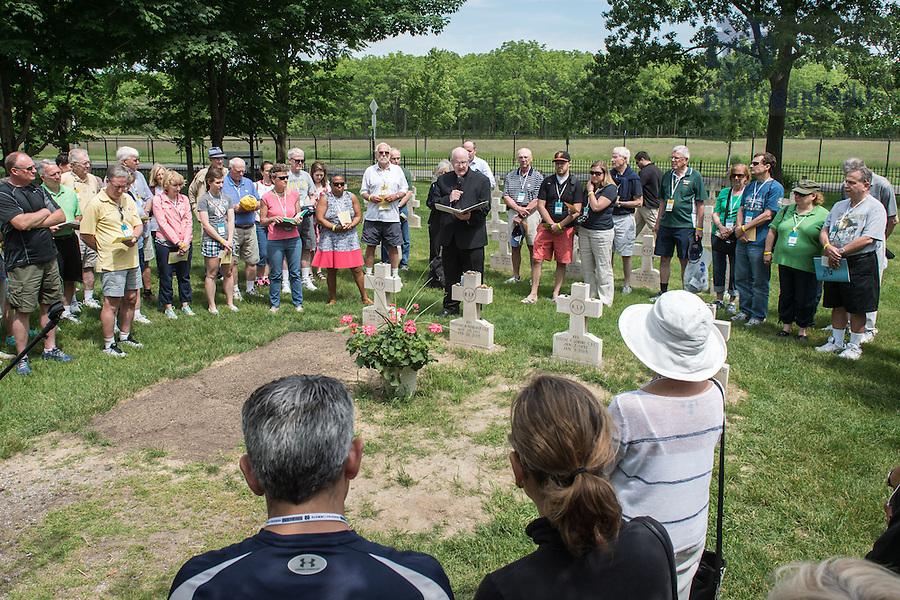 June 5, 2015; Fr. Bill Lies, C.S.C. leads a pilgrimage to Fr. Hesburgh's grave, Reunion 2015. (Photo by Matt Cashore/University of Notre Dame)