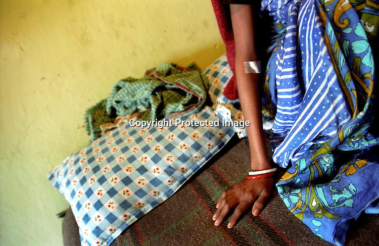 INDIA (West Bengal - Calcutta) -Geeta Das an ex-sex worker now detected HIV POSITIVE and  has to get her blood checked up. She died few weeks later after this photo was taken.- Arindam Mukherjee