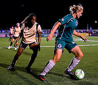 St. Louis Athletica forward Christie Welsh (23) handles the ball in front of FC Gold Pride forward Kandace Wilson (9) during a WPS match at Korte Stadium, in St. Louis, MO, May 9 2009. St. Louis Athletica won the match 1-0.