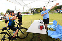 RIDE 'ROUND RAILYARD LOOP<br />Craig Gann (left) of Rogers gets route directions on  Saturday July 17 2021 from Ross Phillips (right) with the Rogers Lowell Area Chamber of Commerce at the Rogers Bike Festival headquartered at Railyard Park in downtown Rogers. RThe festival featured road-bike rides on the 15-mile Raillyard Loop that circles the city and mountain bike rides at Lake Atalanta Park east of downtown. Vendors set up tents to show their wares near Railyard Park's Butterfield Stage, where a concert by The Uncrowned Kings took place after the riding was through. Go to nwaonline.com/210718Daily/ to see more photos.<br />(NWA Democrat-Gazette/Flip Putthoff)