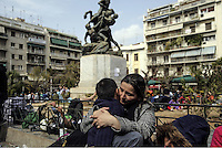 Pictured: A mother clutches her young son in Victoria Square, Athens, Greece Monday 29 February 2016<br /> Re: Hundreds of migrants have been living in Victoria Square in central Athens Greece.