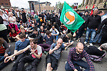 © Joel Goodman - 07973 332324 - all rights reserved . 03/06/2017 . Liverpool , UK . Anti fascists lie in the road and block the EDL march from progressing , outside Liverpool Lime Street Station . Hundreds of police manage a demonstration by the far-right street protest movement , the English Defence League ( EDL ) and an demonstration by opposing anti-fascists , including Unite Against Fascism ( UAF ) . Photo credit : Joel Goodman