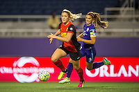 Orlando, Florida - Sunday, May 14, 2016: Western New York Flash defender Abigail Dahlkemper (13) dribbles away from Orlando Pride forward Alex Morgan (13) during a National Women's Soccer League match between Orlando Pride and New York Flash at Camping World Stadium.