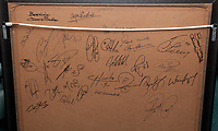 Pictured: Signatures at the back of a commemorative frame showing the players boarding the tragic Munich air disaster aeroplane. Monday 14 November 2011<br />