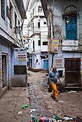 A man walks past the narrow alleys of the ancient city of Varanasi in Uttar Pradesh, India. Photograph: Sanjit Das/Panos