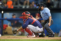 State College Spikes catcher Chris Rivera (32) and umpire John Budka await the pitch during a game against the Batavia Muckdogs on June 24, 2016 at Dwyer Stadium in Batavia, New York.  State College defeated Batavia 10-3.  (Mike Janes/Four Seam Images)