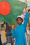In the period leading up to elections, many flags are sold and displayed around Bangladesh. A boy proudly holds out the flag of his nation.