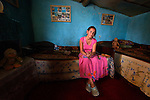 """THIS PHOTO IS AVAILABLE AS A PRINT OR FOR PERSONAL USE. CLICK ON """"ADD TO CART"""" TO SEE PRICING OPTIONS.   A young woman in her one-room house in a largely Roma, Turkish-speaking neighborhood of Dobrich, in the northeast of Bulgaria."""