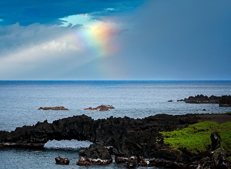 Rainbow at Black sand beach overlook. Waianapanapa State Park, Maui, Hawaii.
